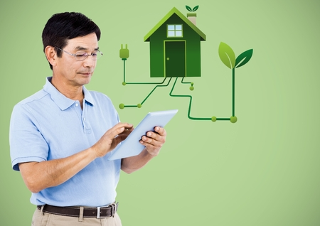 Digital composite of Man with tablet and green house graphic against green background