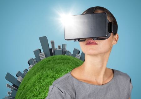 futuristic city: Digital composite of Woman in VR with globe and buildings against blue background Stock Photo