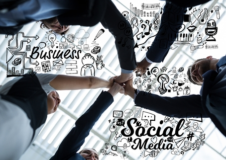chamber: Digital composite of Business people putting hands together with black business doodles Stock Photo