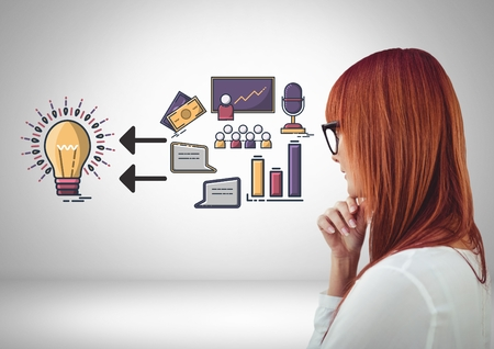 Digital composite of Businesswoman looking at business graphic drawings Stock Photo