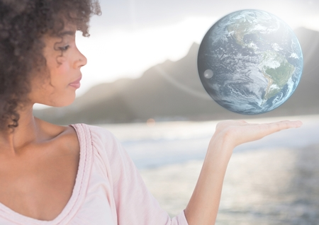 Digital composite of Woman with open palm hand holding world earth globe