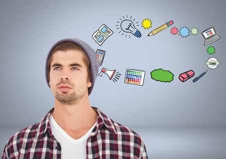 Digital composite of Man with creative design graphic drawings Stock Photo