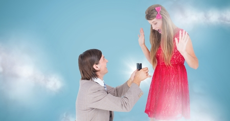 astonishing: Digital composite of Man proposing to woman against blue background with clouds Stock Photo