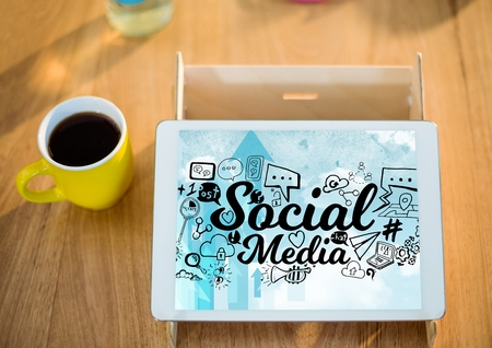 e commerce: Digital composite of Tablet on stand with coffee showing black social media doodles against sky