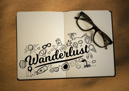 wanderlust: Digital composite of Open book with glasses and black design doodles on sand