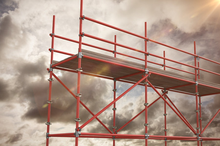 spirit level: Digitally generated image of scaffolding against blue sky with white clouds Stock Photo