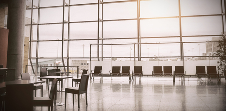 Empty chairs arranged at airport terminal Stock Photo