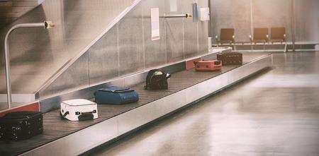Luggage passing through baggage claim at airport