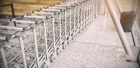 Supermarket trolleys on floor Stock Photo