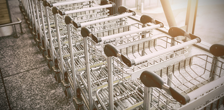 Shopping carts at corridor in supermarket