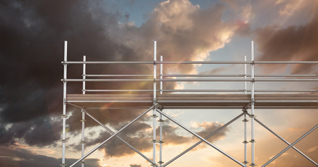 spirit level: Digital composite image of scaffoldings against blue and orange sky with clouds Stock Photo