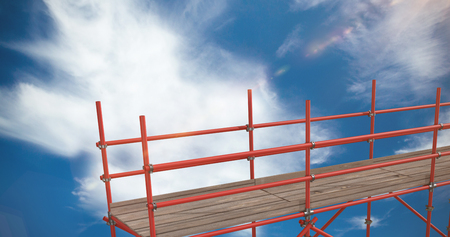 3d image of metal structure with shadow against blue sky with clouds Stock Photo