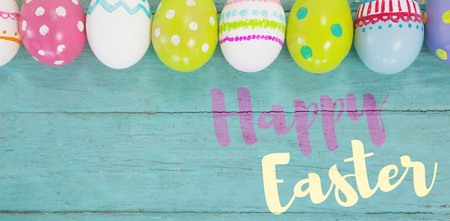 cropped: Easter greeting against various easter eggs arranged on wooden surface