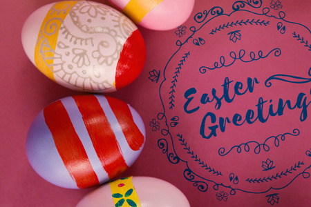 Easter Greetings logo against various easter eggs arranged on pink background