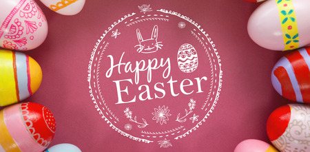 Computer instruction: Happy easter logo against various easter eggs arranged on pink background Stock Photo