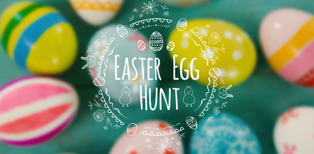 Easter Egg Hunt  against white background against close-up of painted easter eggs Stock Photo