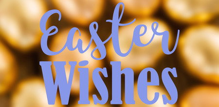 Easter greeting against close-up of golden easter eggs
