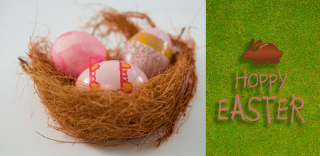 Happy Easter greeting against green background Stock Photo