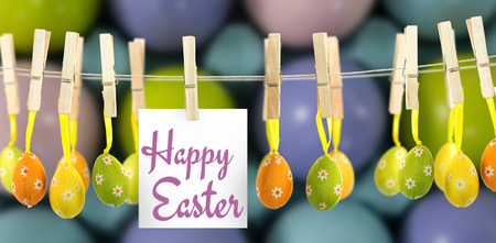 Happy easter logo against multicolored easter eggs in carton Stock Photo