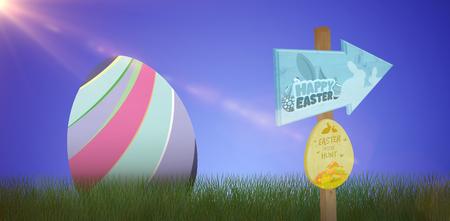 Easter egg hunt sign against grass against white background Stock Photo
