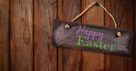 Easter greeting against wood