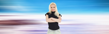 arms folded: Full length portrait of a beautiful casual blond over white background Stock Photo