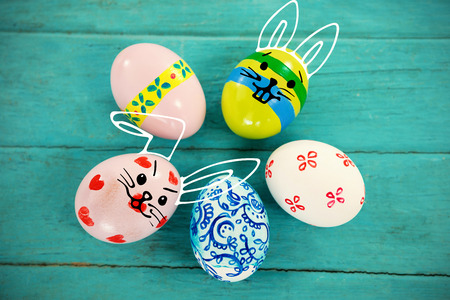 up code: PE047_butterfly_02_bs_nf against multicolored easter eggs against wood background