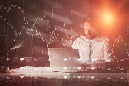 tired businessman: Stocks and shares against businessman using laptop at night