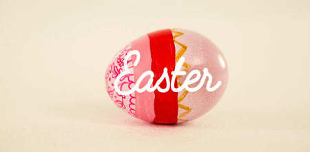 up code: Easter greeting against painted easter eggs on white background Stock Photo