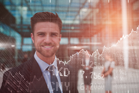 premises: Stocks and shares against portrait of happy businessman Stock Photo