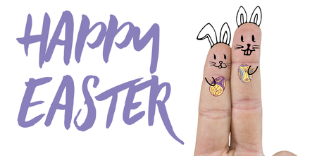 Fingers representing Easter bunny  against easter greeting Stock Photo