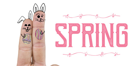 up code: Close up of fingers representing Easter bunny  against easter greeting