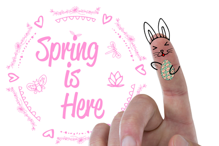 up code: Digitally composite image of fingers representing Easter bunny  against easter greeting