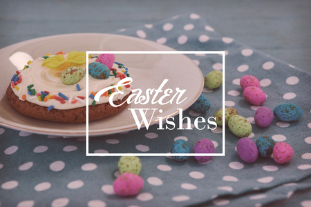 indulgence: Easter greeting against cookie served with chocolates in a tray Stock Photo