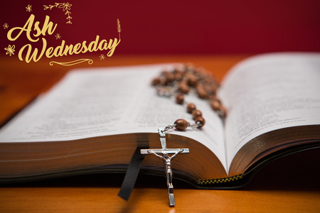 Easter message against rosary beads resting on open bible Stock Photo