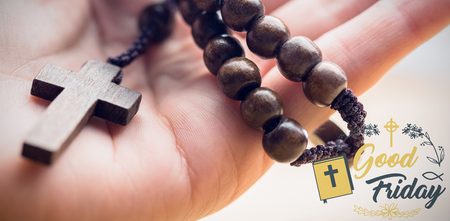Easter message against hand holding rosary beads Stock Photo