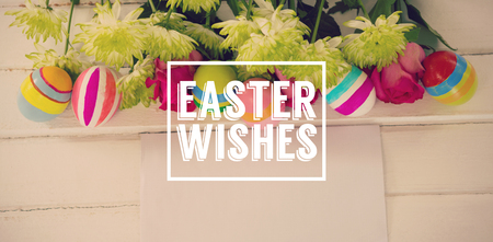 classified: Easter greeting against painted easter eggs with flowers and envelope