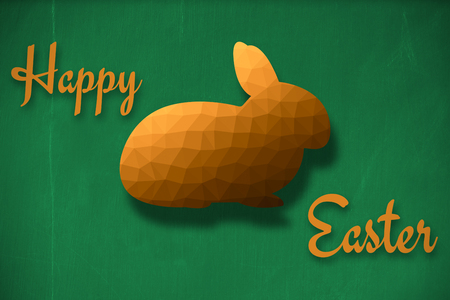 Happy easter  against blackboard with copy space on wooden board