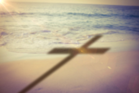 three wishes: Close up of 3d wooden cross against beach during sunset