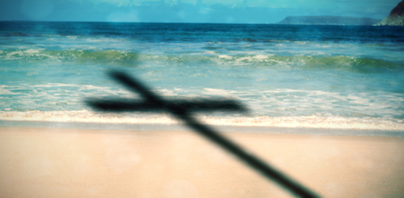 three wishes: Close up of 3d wooden cross against scenic view of beach Stock Photo