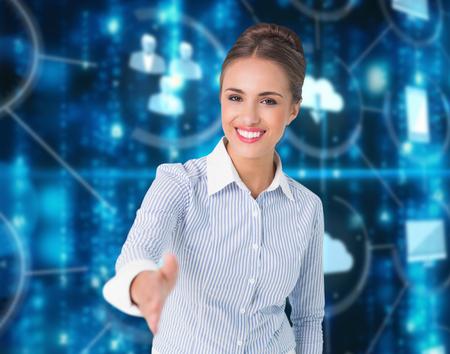 Smiling businesswoman offering handshake against illuminated various icons Digital image of illuminated various connected icons