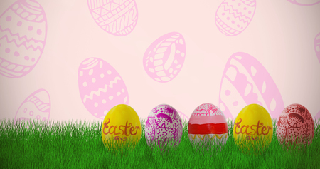 Multi colored Easter eggs side by side against beige background