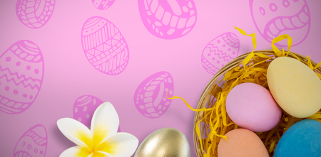 Multi colored Easter eggs against pink background