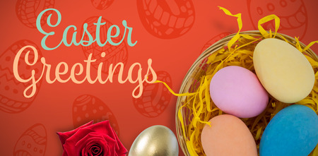 Multi colored Easter eggs against red background