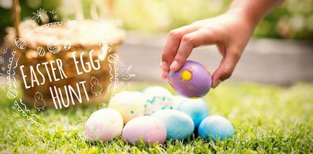 Little girl collecting easter eggs  against easter egg hunt logo against white background
