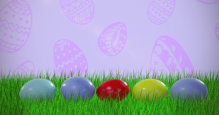 Multi colored easter eggs arranged side by side against purple background Stock Photo