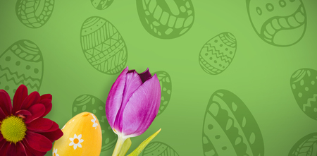 flower and egg against green background