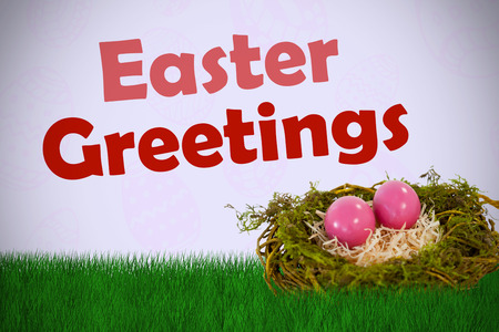 Pink Easter eggs on artificial nest against purple background