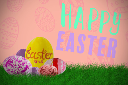 Multi colored patterned easter eggs against orange paper Stock Photo
