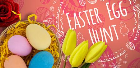 Multi colored Easter eggs against orange paper